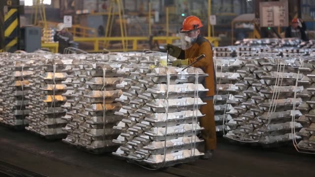 workers mark stacks of aluminium ingots in preparation for shipping in the foundry at the sayanogorsk aluminium smelter operated by united co rusal... - aluminium stock videos & royalty-free footage