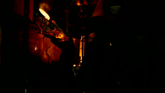 Workers Melting Metal in the Foundry