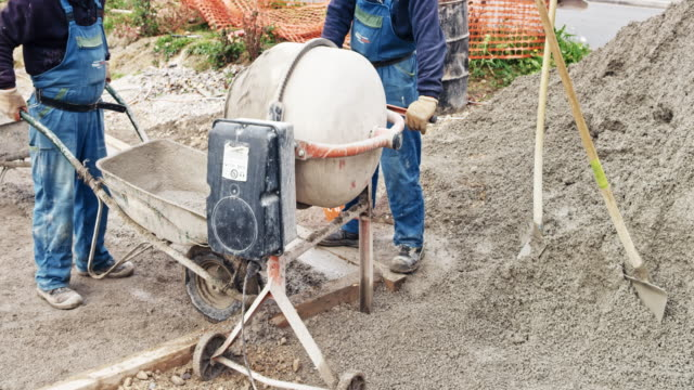 TIME-LAPSE Workers mixing and pouring concrete at the construction site