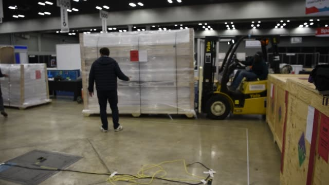 workers move items using fork lifts inside the trade show hall of the austin convention center ahead of the south by southwest interactive festival... - trade show booth stock videos & royalty-free footage