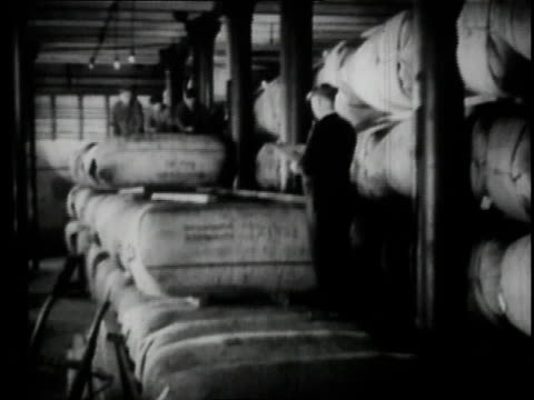1936 b/w workers moving hops bales at anheuser busch brewery in st. louis / missouri, united states  - anheuser busch inbev stock videos and b-roll footage