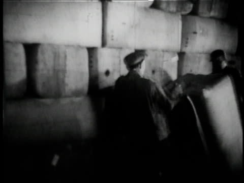1936 B/W workers moving hops bales at Anheuser Busch brewery in St. Louis / Missouri, United States