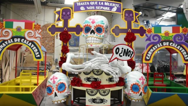 workers of the 'taller el volador' made the manufacture of skulls and catrinas that will be used for the day of the dead parade inspired by the most... - james bond film series stock videos and b-roll footage