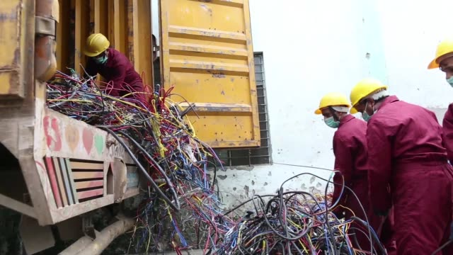 workers offload cables from a truck at the attero recycling pvt facility in the raipur industrial area of bhagwanpur in roorkee uttarkhand india on... - e waste stock videos & royalty-free footage