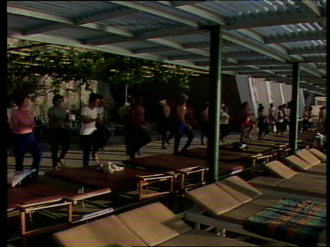 workers on annual holiday in tradeunion funded soviet sanatorium doing exercises in early morning yalta - aerobics stock videos & royalty-free footage