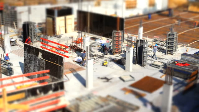 t/l workers on construction site (tilt shift effect) - baugewerbe stock videos & royalty-free footage