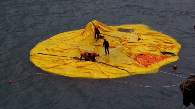 Workers on deflated Rubber Duck in Hong Kong