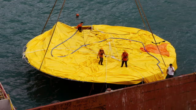 workers on deflated rubber duck in hong kong - yellow stock videos & royalty-free footage