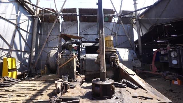 Workers on the drill floor during drilling operations by DK Ukrgazvydobuvannya a unit of NAK Naftogaz Ukrainy in Poltava Ukraine on Friday July 21...