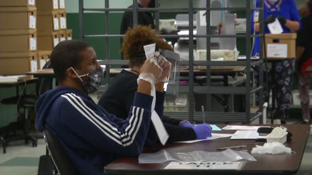 "workers open and count mail-in ballots in orlando, florida, which is a vital battleground state. ""we are still counting but we received about 280,000... - florida us state stock videos & royalty-free footage"