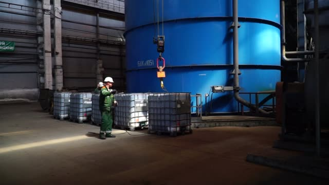 Workers operate machinery to filter iron ore content ahead of pelletisation at the Yeristovo and Poltava iron ore mine operated by Ferrexpo Poltava...