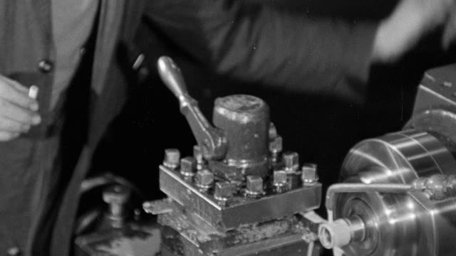 b/w montage workers operating machinery in a world war ii munitions factory / england, united kingdom - 1942 stock videos & royalty-free footage