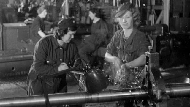 vidéos et rushes de b/w montage workers operating machinery in world war ii munitions factory / england, united kingdom - guerre