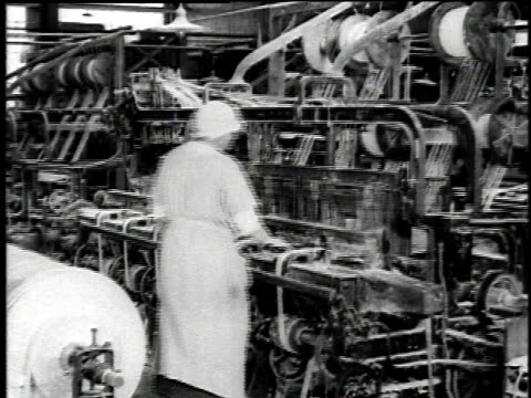 1921 MONTAGE Workers operating machines creating asbestos yarn and piles of brake lining bands / Waukegan, Illinois, United States