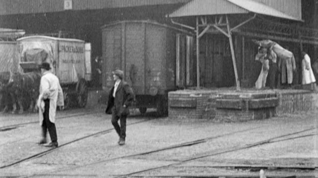 stockvideo's en b-roll-footage met 1917 pan workers outside of a food supply warehouse / united kingdom - 1917