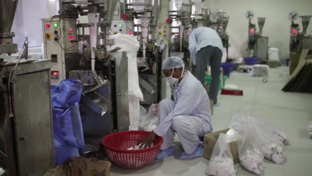 workers pack sachets of sugar into plastic bags in the packaging unit of the simbhaoli sugars ltd mill in ghaziabad uttar pradesh an employee scoops... - sachet stock videos & royalty-free footage