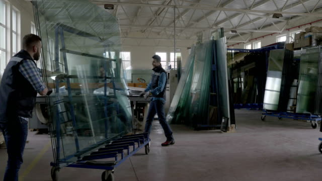workers packaging glass sheets in warehouse - installing stock videos and b-roll footage