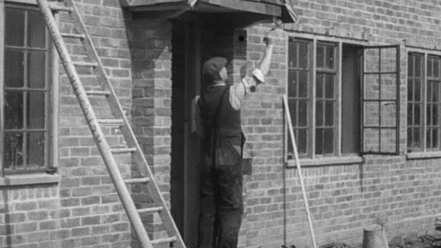 montage workers painting cottage / london, england, united kingdom - brick house stock videos & royalty-free footage