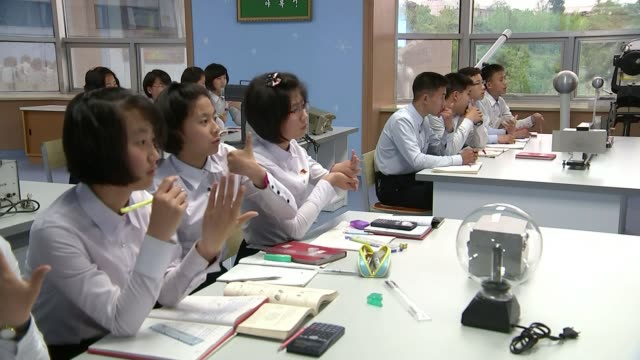 workers party congress north korea pyongyang int small children singing and doing actions to song in praise of north korea nursery school children... - tram point of view stock videos and b-roll footage