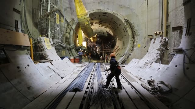vídeos de stock, filmes e b-roll de workers place steel rods inside the tunnel emisor oriente or eastern discharge tunnel during construction of the 38 mile underground wastewater... - esgoto