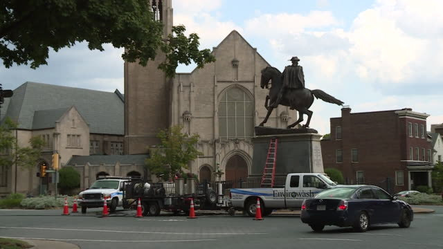 wtvr workers powerwash tar off the monument to confederate general jeb stuart at monument and n lombardy street in richmond virginia on aug 26 2017... - richmond virginia stock videos & royalty-free footage