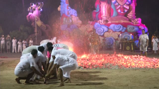 workers prepare burning coals for firewalking at the phuket vegetarian festival in phuket town thailand the event is held over a nineday period in... - phuket stock videos & royalty-free footage