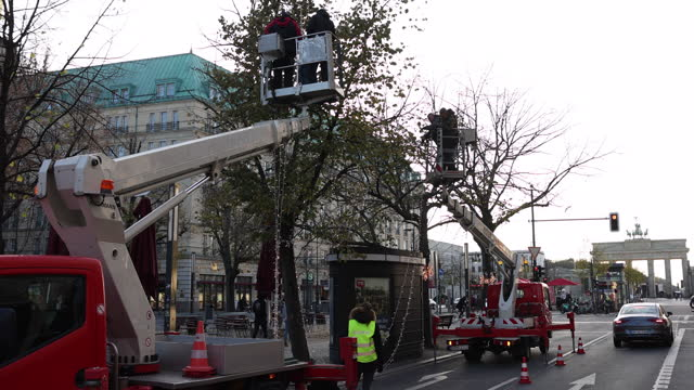 workers prepare christmas decorations and lights in the street unter den linden near the brandenburg gate during a fourweek semilockdown during the... - advent calendar stock videos & royalty-free footage
