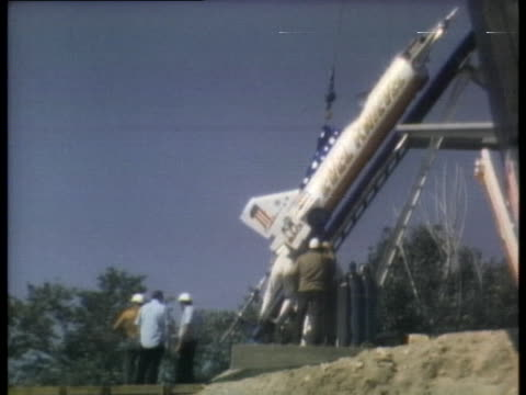 workers prepare evel knievel's rocket for his jump across the snake river canyon. - stunt stock videos & royalty-free footage