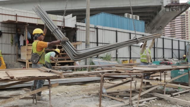 Workers prepare reinforcing steel at the construction site of the Ekovest Bhd Ekotitiwangsa residential development in Kuala Lumpur Malaysia on...