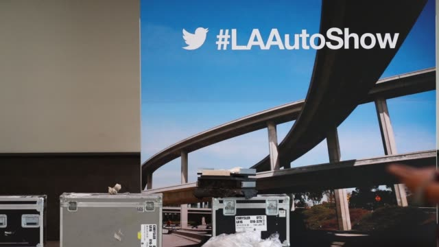 workers prepare the ford motor co booth during preparations for automobility la ahead of the los angeles auto show in los angeles california us on... - motor show stock videos and b-roll footage