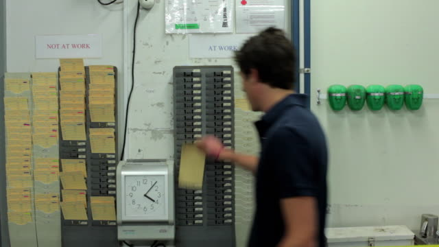 ms workers punching time card in to punch clock / perth, western australia, australia - punching stock videos and b-roll footage