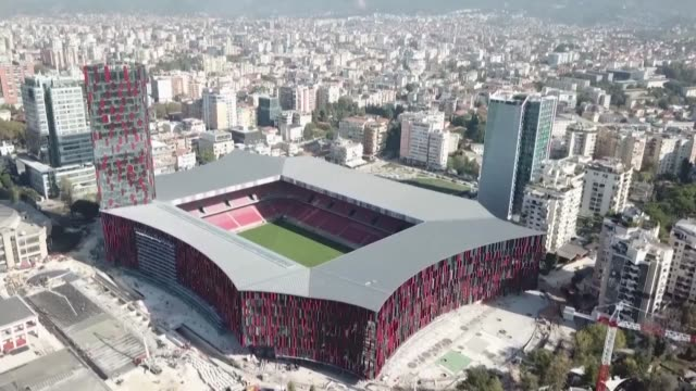 workers put the final touches to a new stadium in tirana where the albanian national team will host world cup champions france sunday for their final... - tirana stock videos and b-roll footage