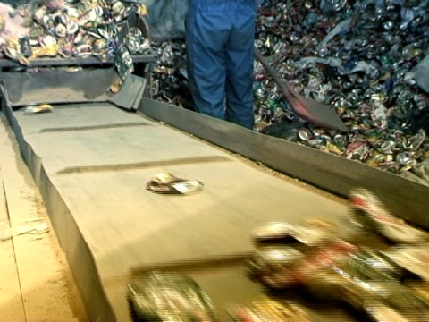 MS, Workers putting aluminum cans on conveyor belt in factory