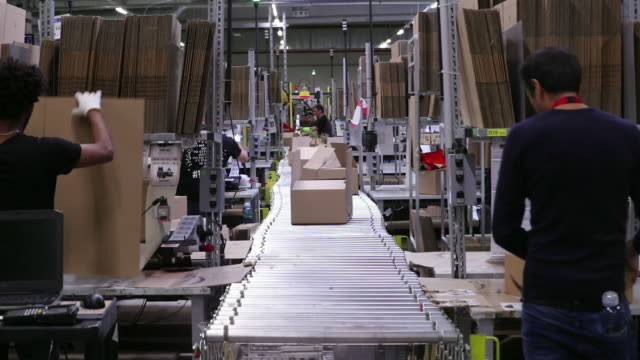 workers putting packages on conveyor belt at amazon warehouse koblenz rheinlandpfalz germany on monday july 15 2019 - promotion employment stock videos & royalty-free footage