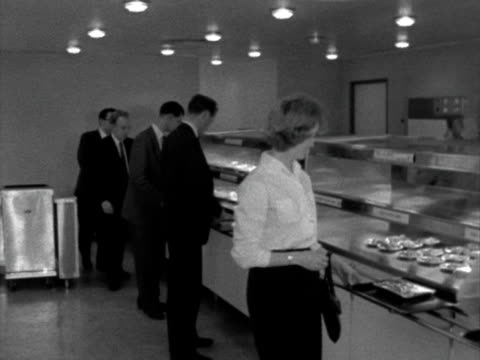 workers queue up in a factory canteen. - canteen stock videos & royalty-free footage