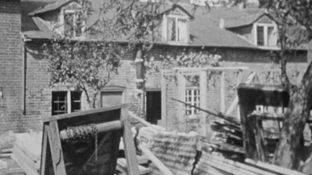 stockvideo's en b-roll-footage met montage workers remodeling rural dwellings / united kingdom - breedbeeldformaat