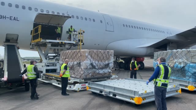 workers remove boxes of ppe supplies arriving from tianjin china from the nhs branded plane at bournemouth international airport during the... - commercial aircraft stock videos & royalty-free footage