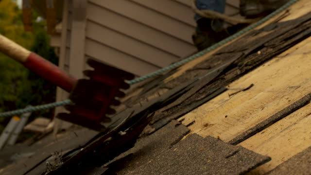 workers remove old shingles - rebuilding stock videos and b-roll footage