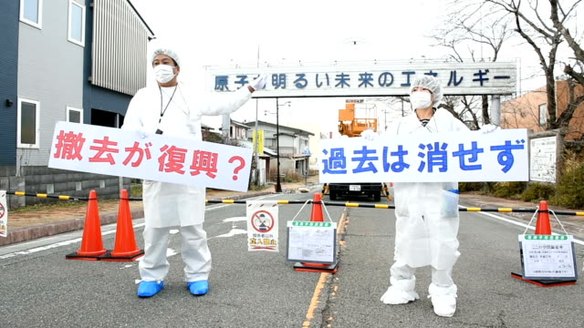 workers removed lettering of a signboard that praises nuclear energy here despite opposition from the slogan writer who became an antinuclear... - hometown stock videos and b-roll footage