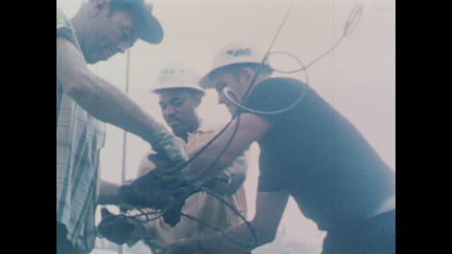 workers repair cable on large crane - 1967 stock videos & royalty-free footage