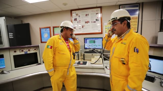 vídeos y material grabado en eventos de stock de workers repair items in the electric department at the petroleos mexicanos pemex pol a platform complex located on the continental shelf in the gulf... - pemex