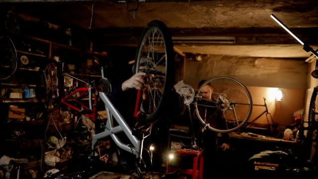 workers repairing bicycles in workshop - second hand stock videos & royalty-free footage