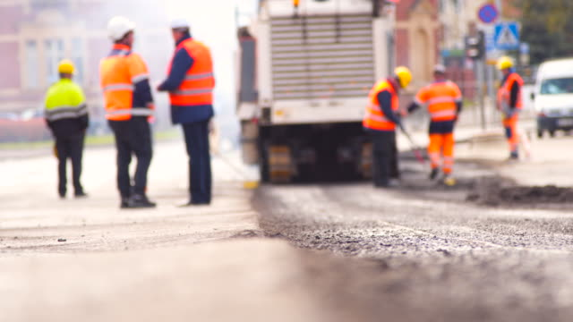 workers repairing road - summer heat stock videos & royalty-free footage