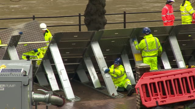 workers repairing temporary flood defences in ironbridge - protection stock videos & royalty-free footage