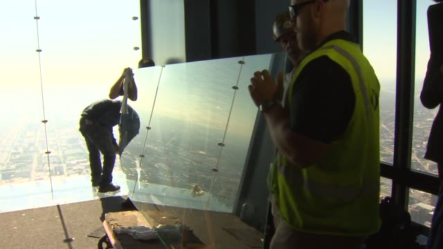 workers replaced the glass in standing area of the transparent observation deck ledge in the willis tower skydeck on may 29 2014 in chicago illinois - sostituzione video stock e b–roll