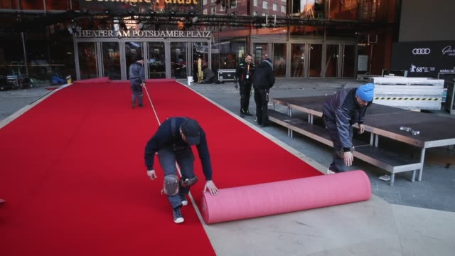 workers roll out the red carpet at the berlinale palace prior to the 68th berlinale international film festival on february 13 2018 in berlin germany... - teppich stock-videos und b-roll-filmmaterial