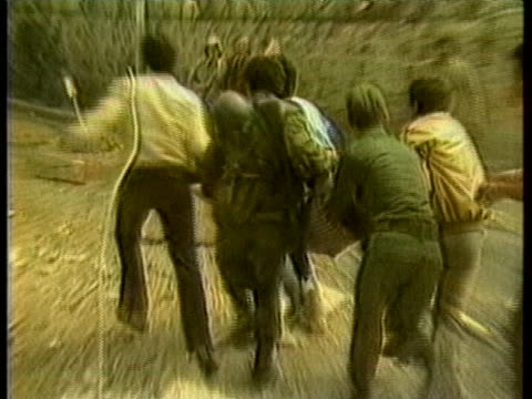 stockvideo's en b-roll-footage met workers run among rubble to rescue people after the 1983 beirut barracks bombing - 1983