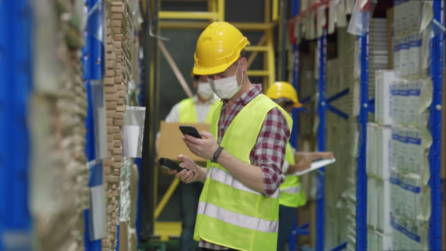 workers scanning and checking goods stock on shelf in warehouse inventory - compartment stock videos & royalty-free footage