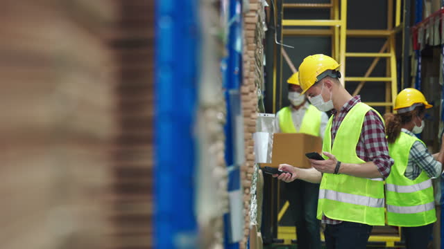 workers scanning and checking goods stock on shelf in warehouse inventory - employment and labor stock videos & royalty-free footage