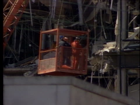 workers search through the wreckage of the a.p. murrah federal builidng. - oklahoma city bombing stock videos & royalty-free footage